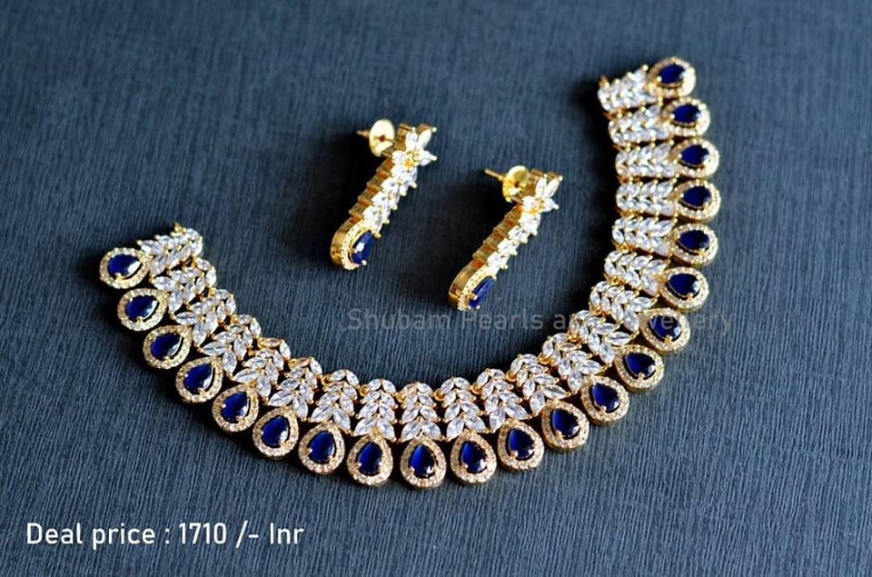 Stunning one gram gold choker studded with white blue color CZs. Choker with matching earrings. Price : 1710/-