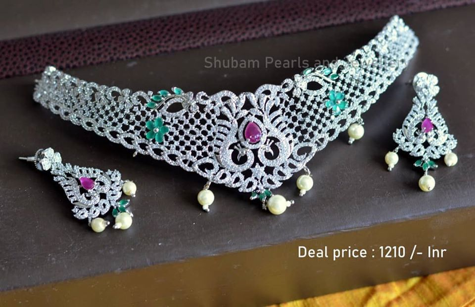 Beautiful imitation choker studded with white pink and green color CZs. Choker with matching earrings.