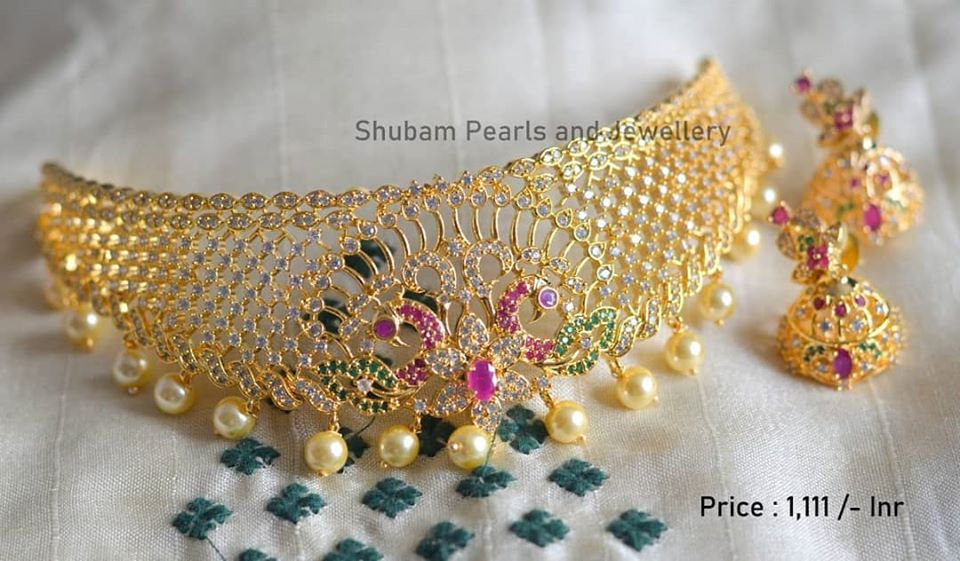 Stunning one gram gold choker studded with white green and pink color CZs. Necklace with macthing earrings. Price : 1111/-