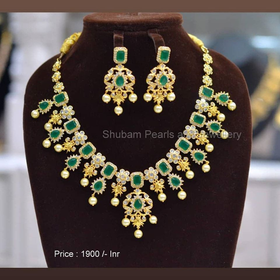 Gorgeous one gram gold necklace studded with green adn white color CZS. Necklace with matching earrings. Price :  1900/-