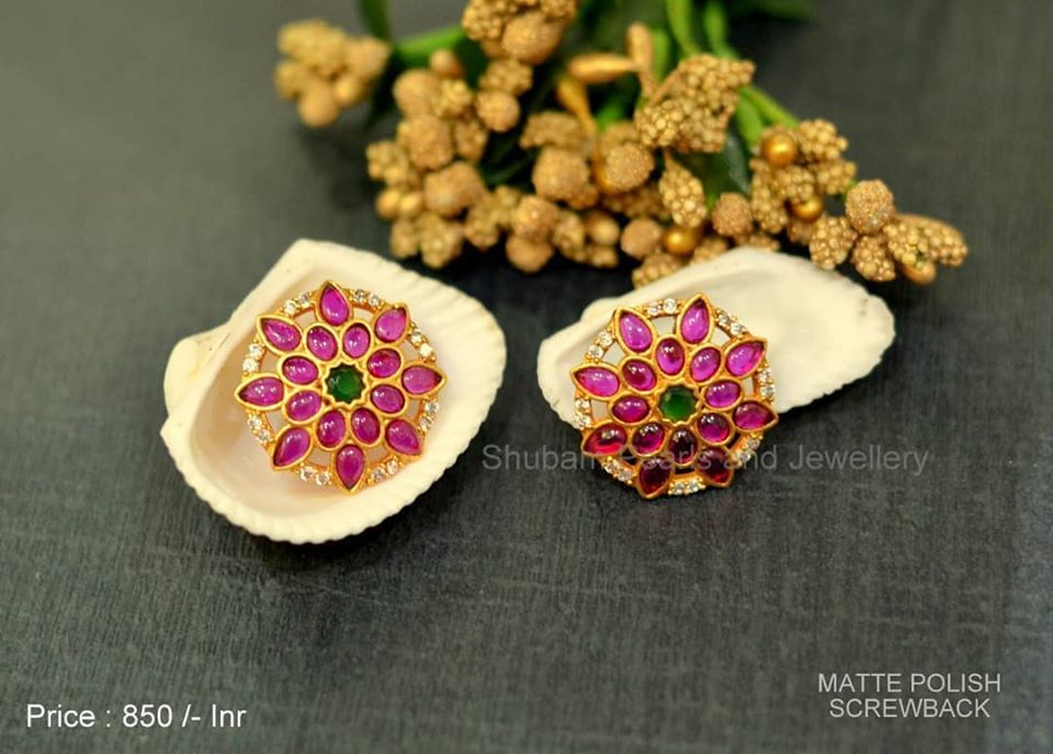 Gorgeous matt gold finish ear tops studded with multi color stones. Price 