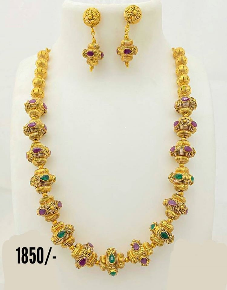 Beautiful one gram gold necklace studded with pink and green color stones. Necklace with matching earrings. Price  1850.