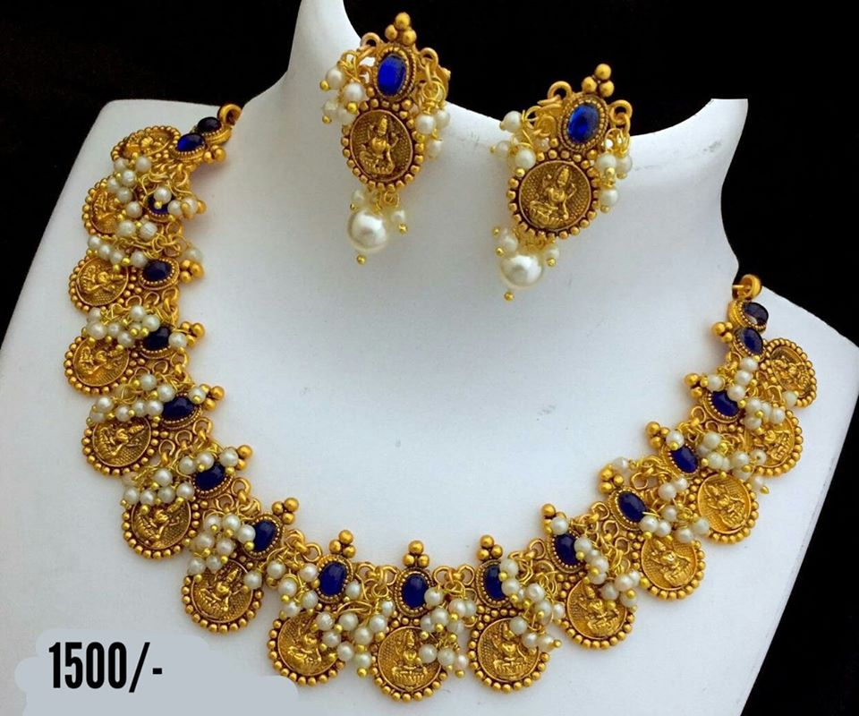 Stunning one gram gold necklace with Lakshmi kasu hangings. Necklace studded with blue color stones. Necklace with matching earrings. price  1500/-