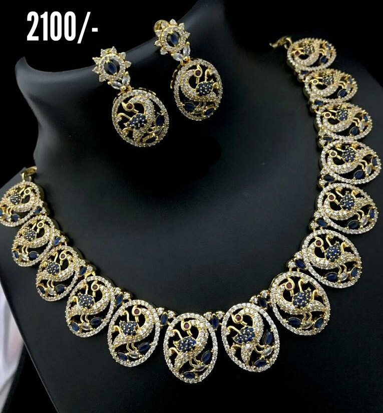 Beautiful one gram gold necklace with peacock design and matching earrings.  Price : 2100/