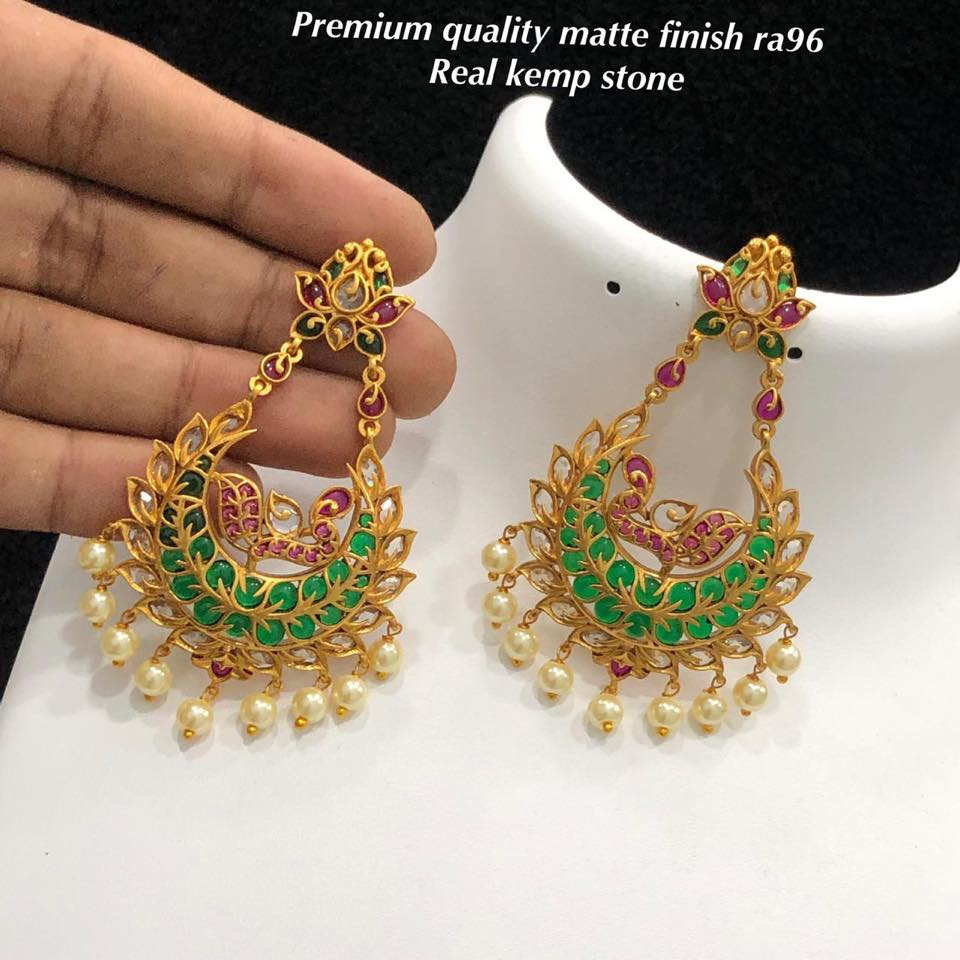 Stunning gram gold chaandbali studded with multi color stones.