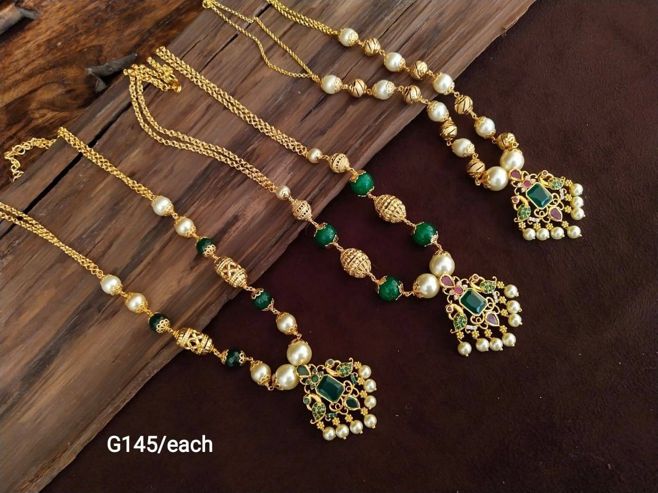 Beautiful one gram gold simple necklace with Lakshmi devi pendant and pearl beads.