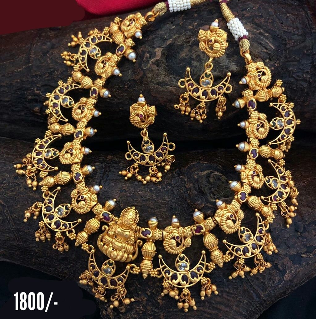 Stunning one gram gold necklace with Lakshmi devi motif and chaandbali hangings. Price : 1800/-