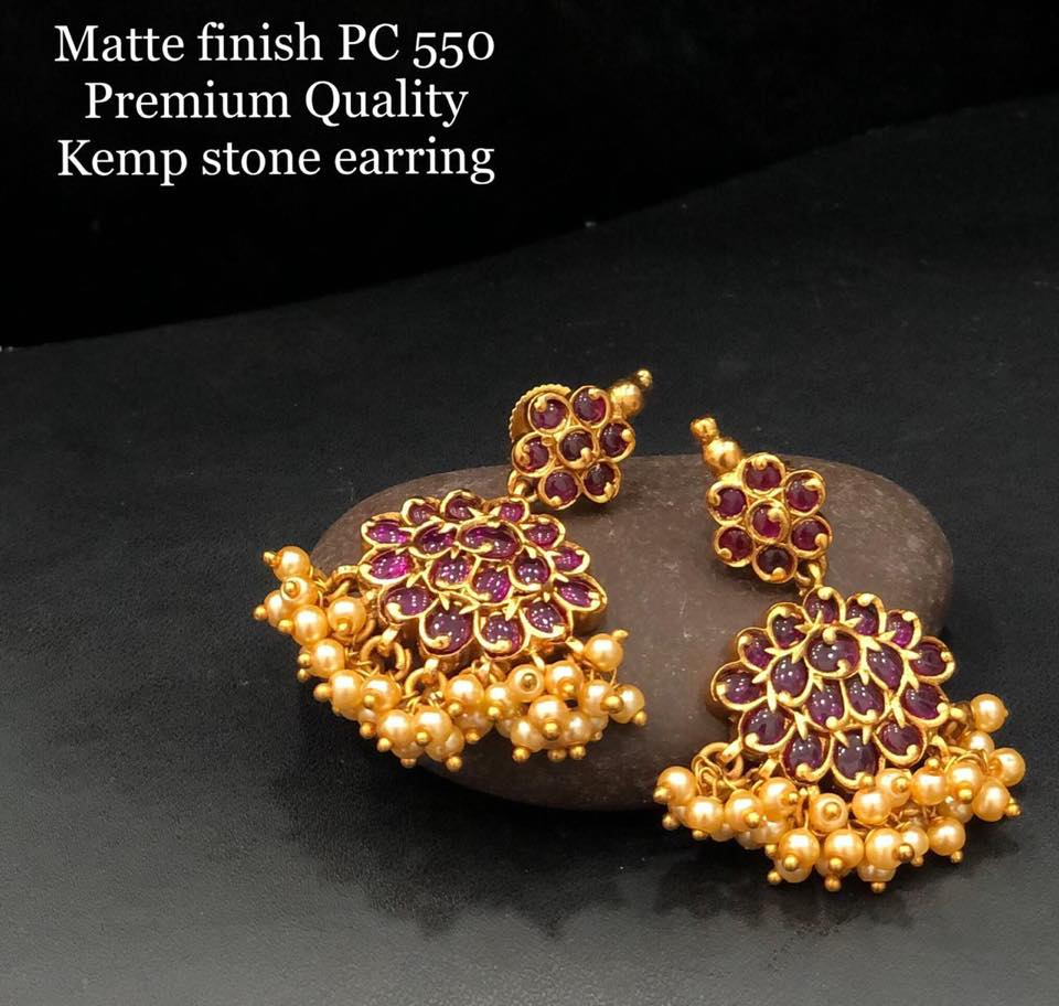 Gorgeous one gram gold earrings studdedwith pink color stones. Earrings with guttapusalu hangigns.