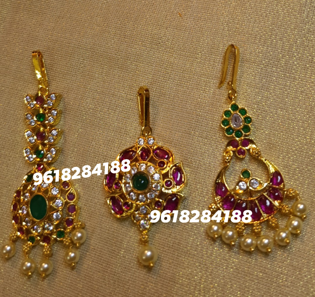 Gorgeous one gram gold pendant and matching chandbali studded with pink and green color stones. Price :600 plus shipping