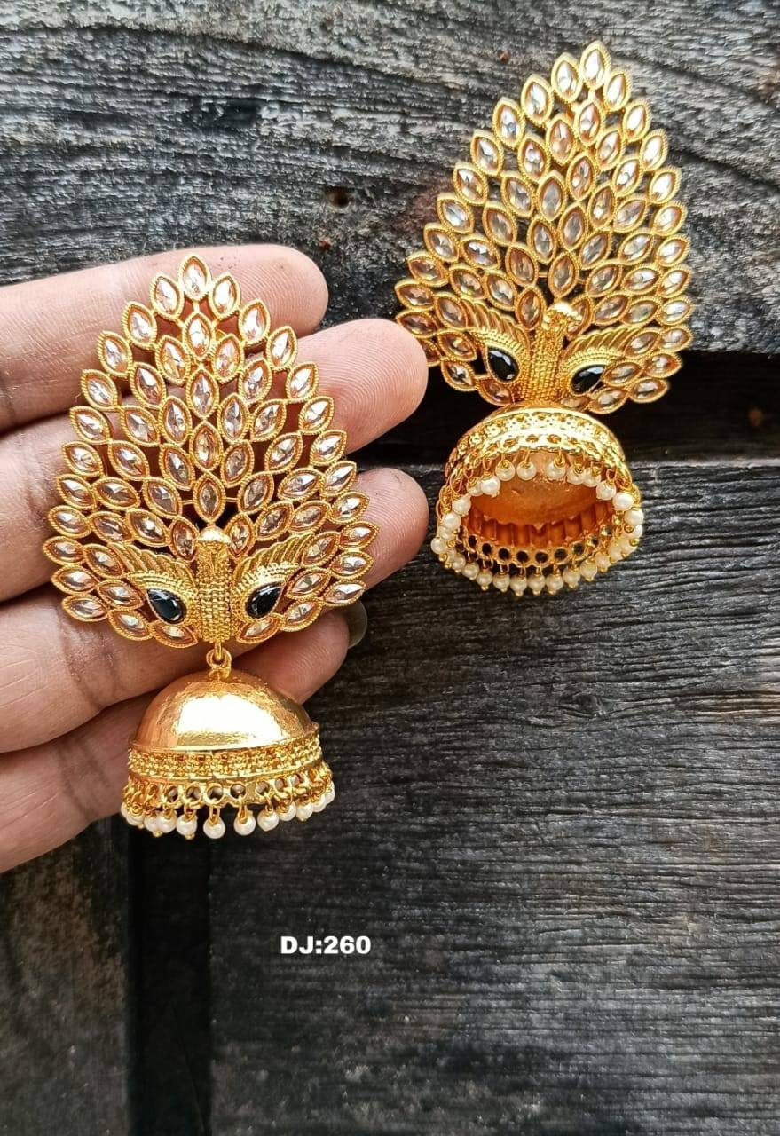 Stunning one gram gold jumkhis in dancing peacock design. Jumkhis studded with multi color CZS. 1 gram gold online one gram gold jewellery shops in begum bazar latest one gram gold necklace