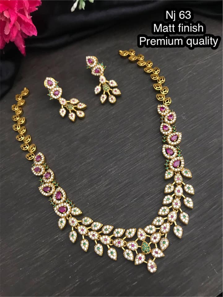Stunning one gram gold necklace studded with multi color stones. latest one gram gold jewellery one gram gold thali chain one gram gold cz jewellery with price