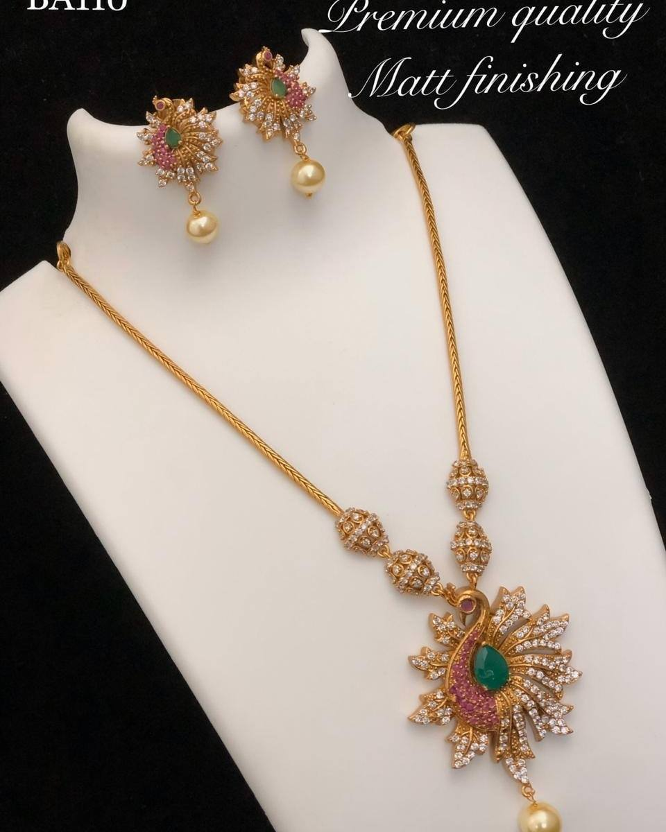 Beautiful one gram gold long chain with peacock pendant and matching earrings. one gram gold long haram designs 1 gram gold chains online 1 gram gold chain design