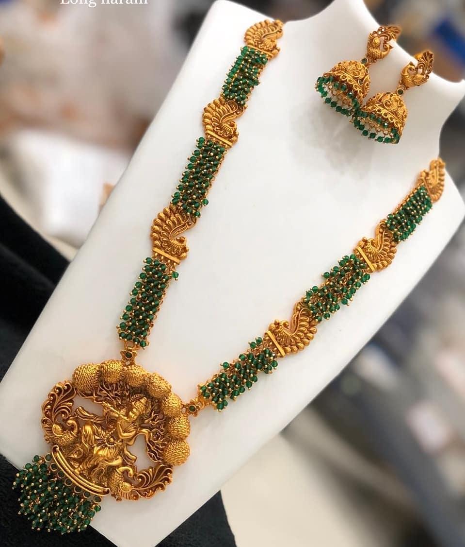 Gorgeous one gram gold green bead peacock long haaram.
