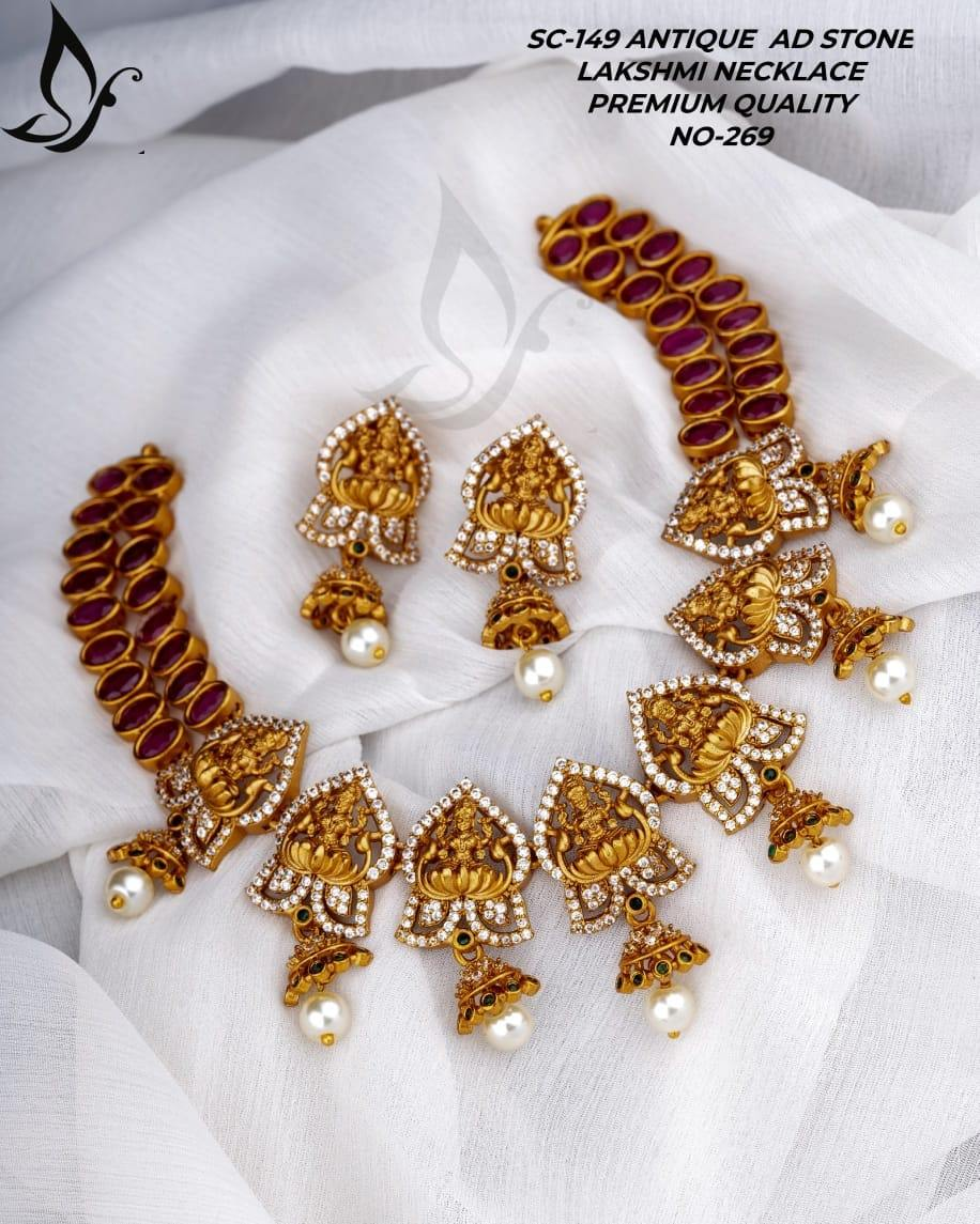 Beautiful one gram gold necklace with Lakshmi devi motifs and matching earrings. 1 gram gold jewellery with price one gram gold jewellery one gram gold temple jewellery