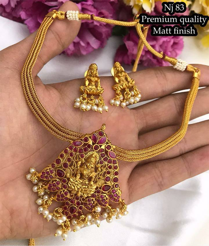 Gorgeous one gram gold necklace with Lakshmi devi pendant and matching earrings. one gram gold online purchase 1gram gold jewelry one gram gold chains online shopping