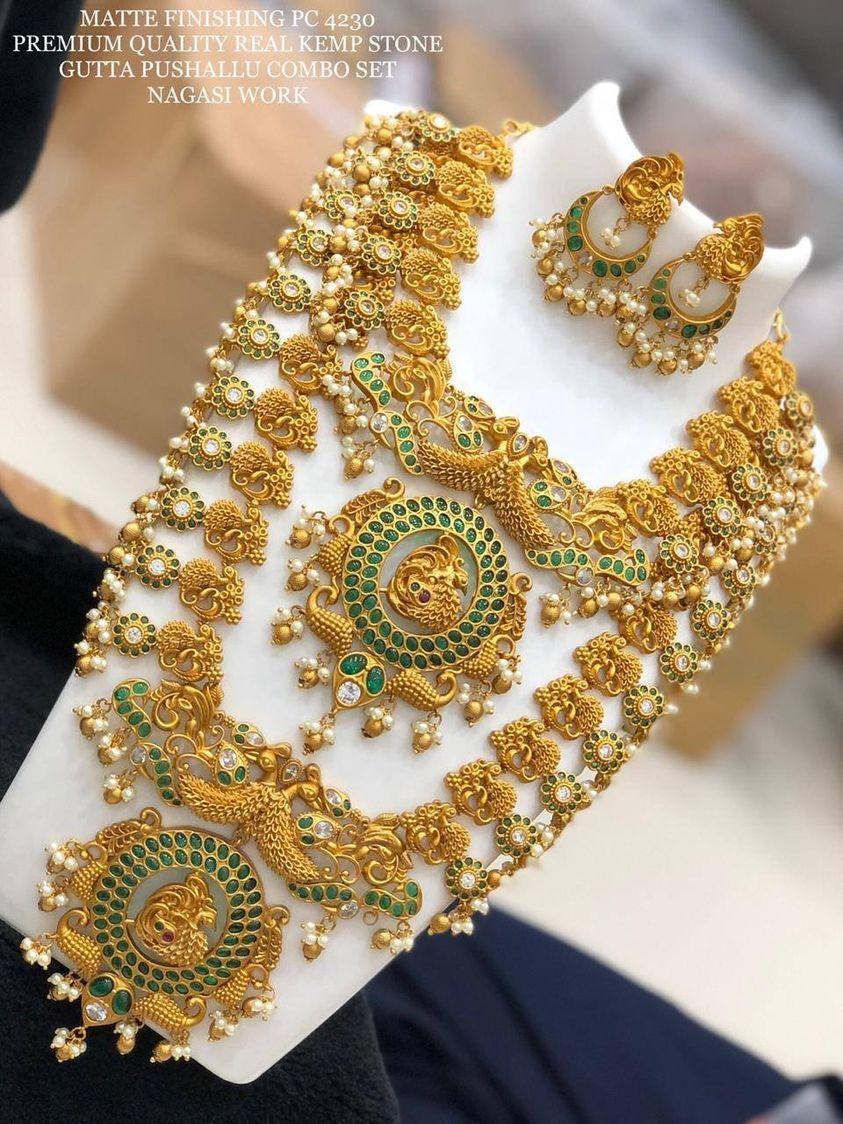 Beautiful one gram gold guttapusalu bridal set. bridal set studded with green kempus.