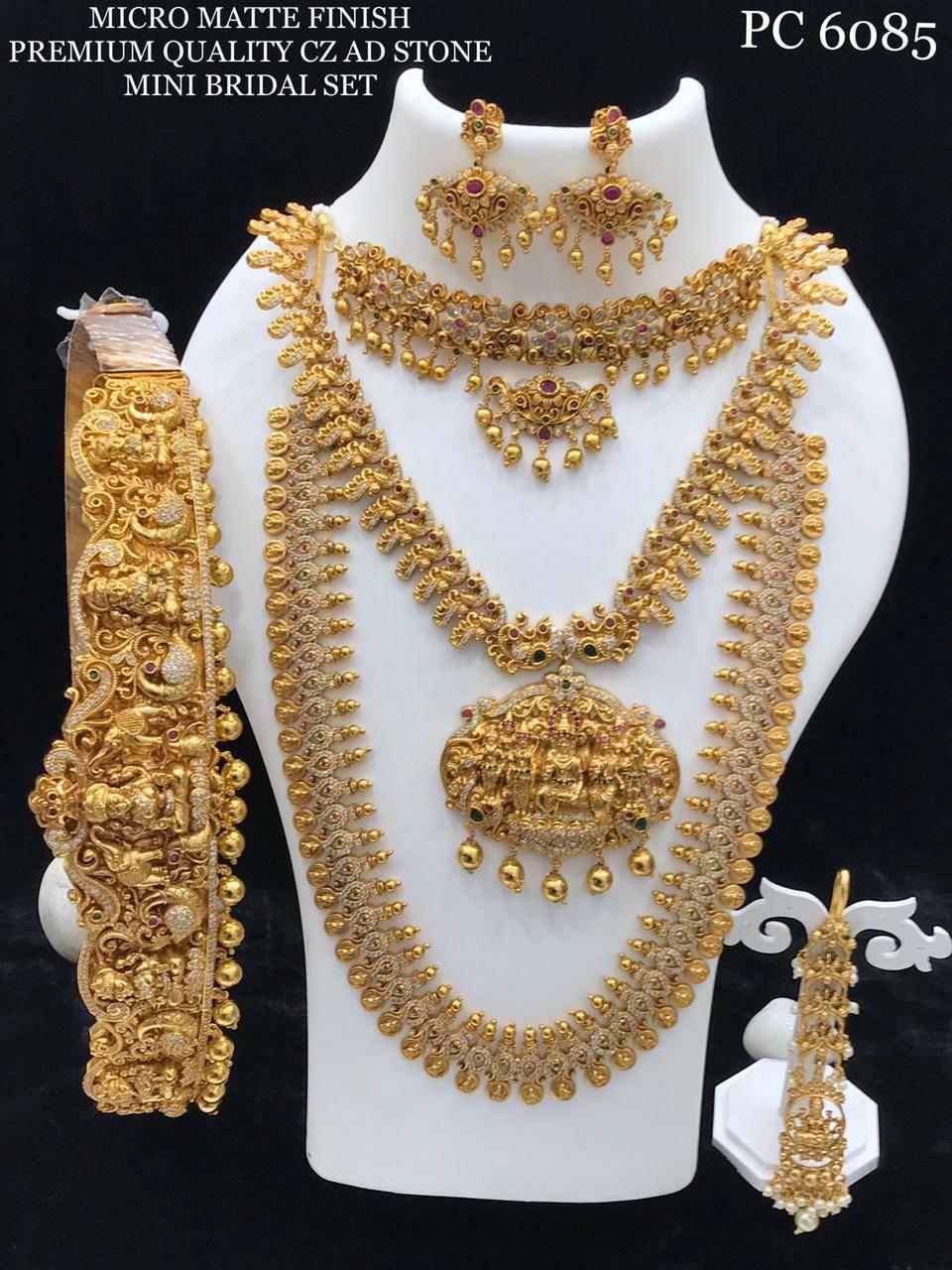 Stunning one gram gold CZ AD mini bridal set.