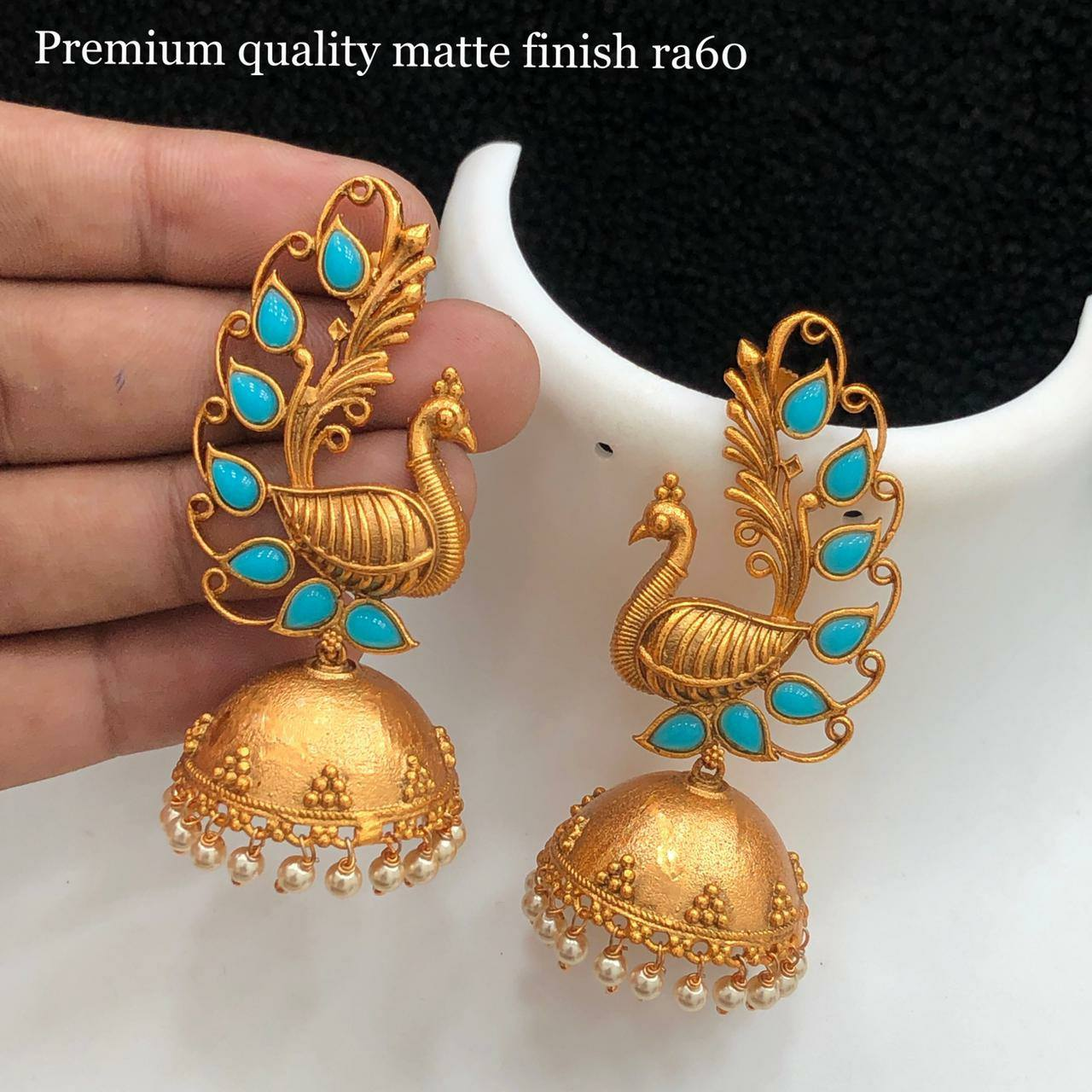 Beautiful one gram gold peacock jumkhis studded with blue beads. 1 gm gold chain online 1 gram gold chain designs with price 1grm gold jewellery online