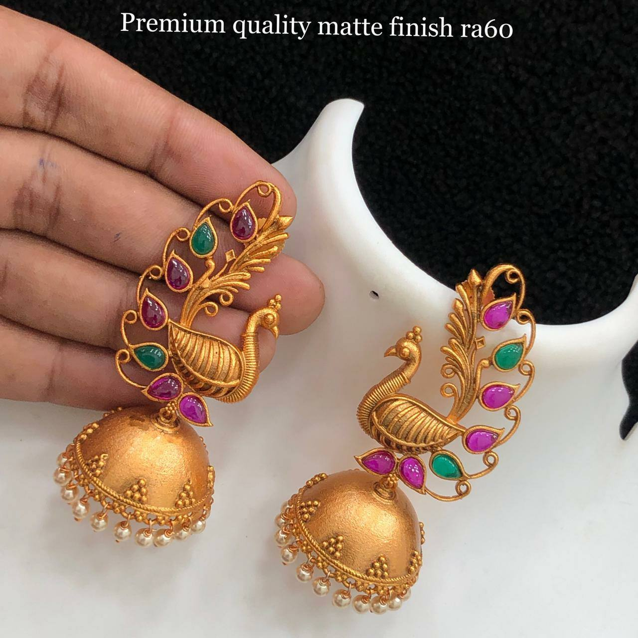 Beautiful one gram gold peacock jumkhis studded with pink and green beads. 1 gram gold jewellery wholesale 1 gram earrings gold lali mix one gram gold