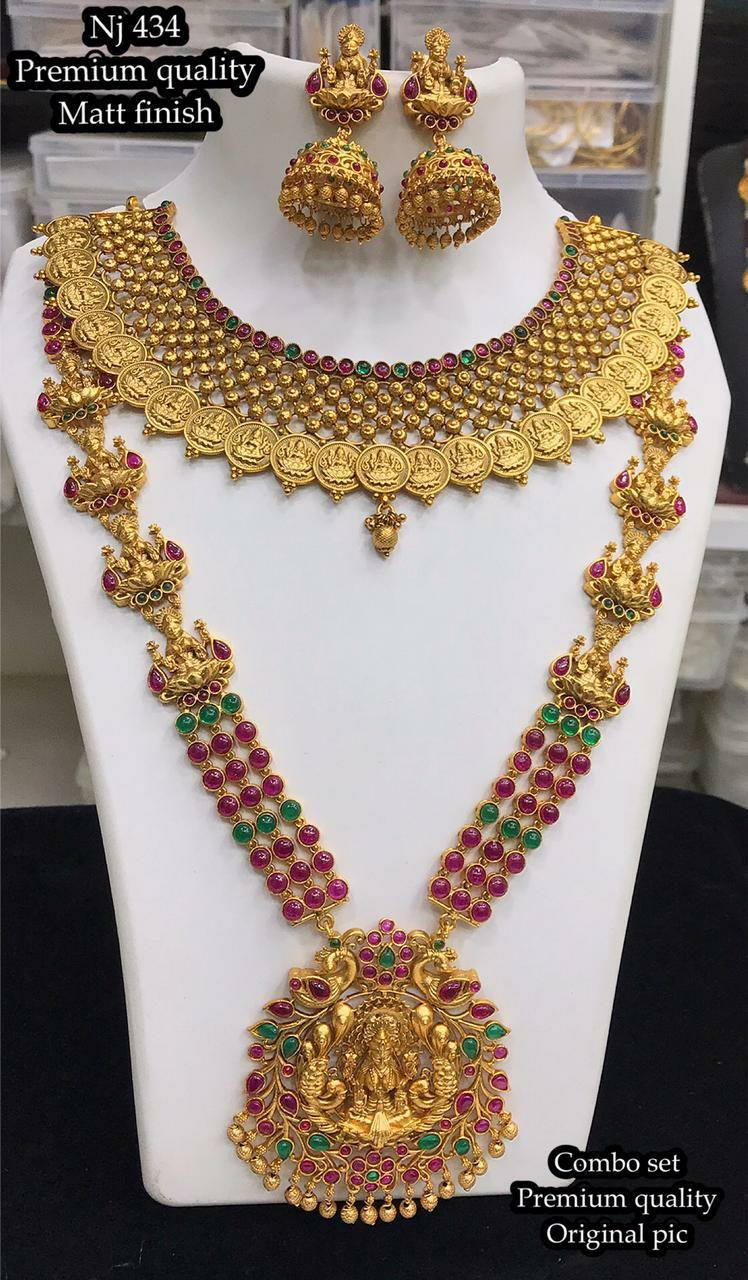 Gorgeous one gram gold bridal set with Lakshmi kasu choker and long haaram.