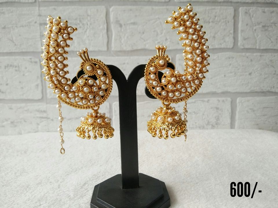 Stunning lovely one gram gold peacock earrings studded with white beads. Price  600/ one gram gold sets one gram gold ornaments with price 1 gram gold baby earrings