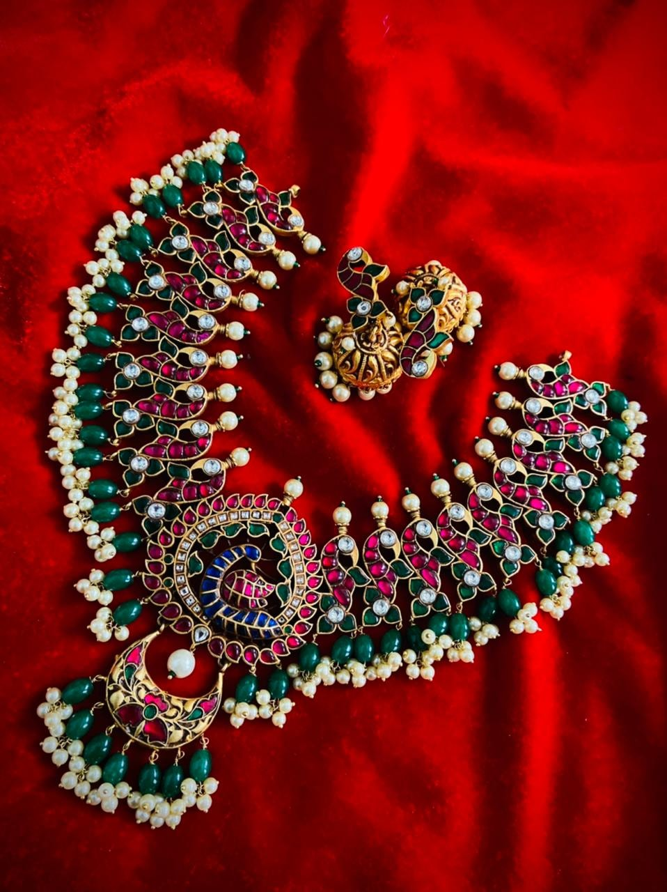 Stunning one gram gold necklace with peacocks and studded with multi color stones. one gram gold necklace designs with price one gram gold jewellery designs with price one gram gold necklace designs with price