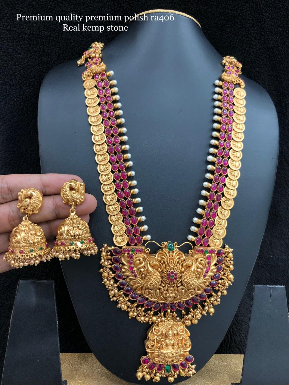 Stunning one gram gold Lakshmi haaram with Peacock pendant. Long haaram studded with pink color stones. one gram gold jewellery long chains one gram jewellery designs 1 gm gold ornaments