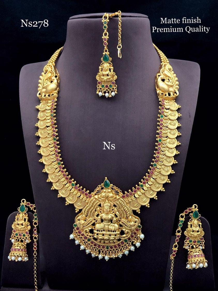 Stunning one gram gold Lakshmi haaram with Peacock pendant. Long haaram studded with pink color stones. 1 gram gold mix jewellery one gram gold imitation jewellery one gram jewellery designs
