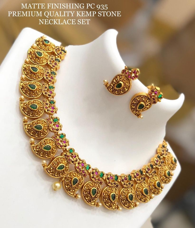 Gorgeous one gram gold necklace with mango hangings. Necklace with matching earrings. 1 gram gold jewellery with price 16 grams gold necklace models one gram gold cz jewellery