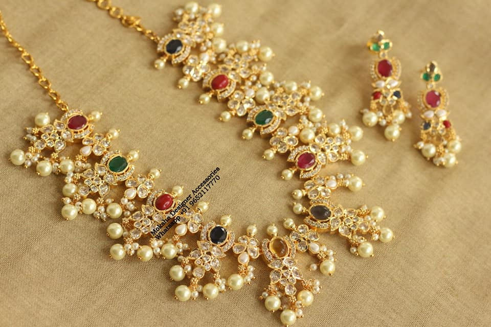 Beautiful one gram gold necklace studded with multi color stones and matching earrings. one gram gold wedding jewellery sets latest one gram gold necklace one gram gold jewellery with price