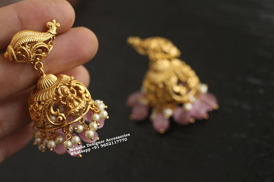 Beautiful one gram gold Lakshmi jumkhis with pink bead hangings.