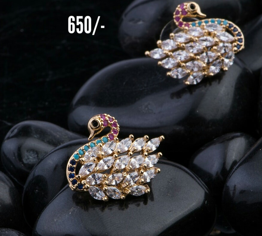 Gorgeous one gram gold swan studs studded with multi color CZs. 1 gram gold jhumkas buy online 1 gram gold set design one gram gold jewellery sets