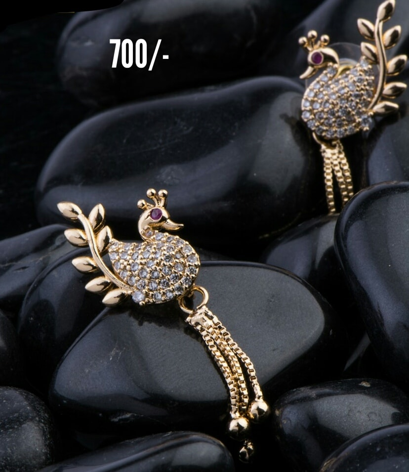 Gorgeous one gram gold swan studs studded with multi color CZs. Price : 700. 1 gram gold jhumkas buy online 1 gram gold set design one gram gold jewellery sets
