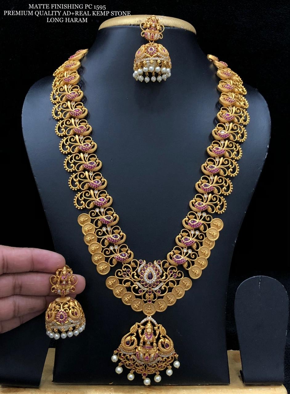 Stunning one gram gold long haaram with peacocks and Laksmi kasu hangings. Long haaram with matching earrings. 1 gram gold bridal jewellery sets with price 1 gram gold jewellery online shopping cash on delivery one gram gold jewellery sets with price