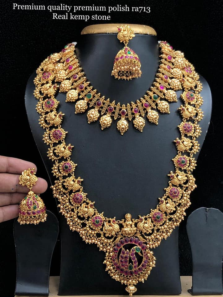 Beautiful premium quality one gram gold necklace studded with real kemp stones. Necklace with matching jumkhis. One gram gold bridal set.