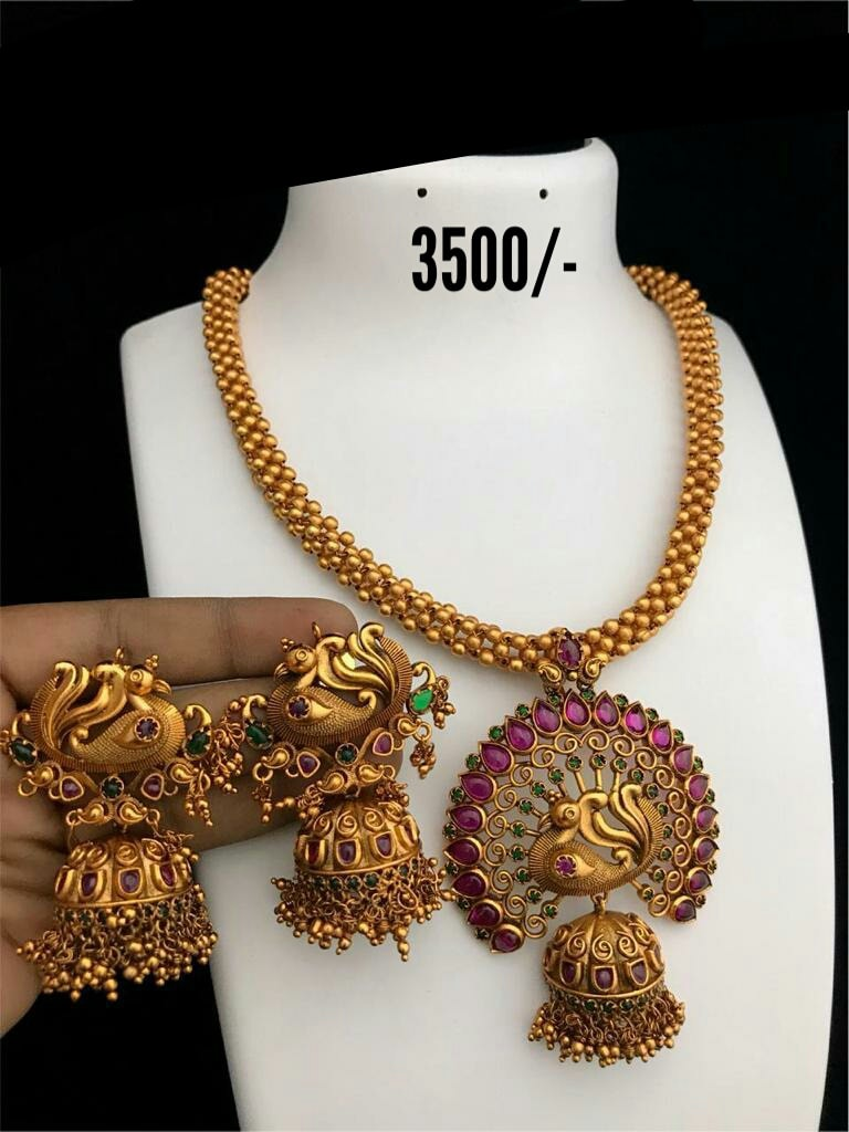 Gorgeous one gram gold or Matt finish gold ball necklace with peacock pendant and matching jumkhis.  Price : 3500/- one gram gold necklace 1 gram gold bridal sets with price 1 gram necklace set