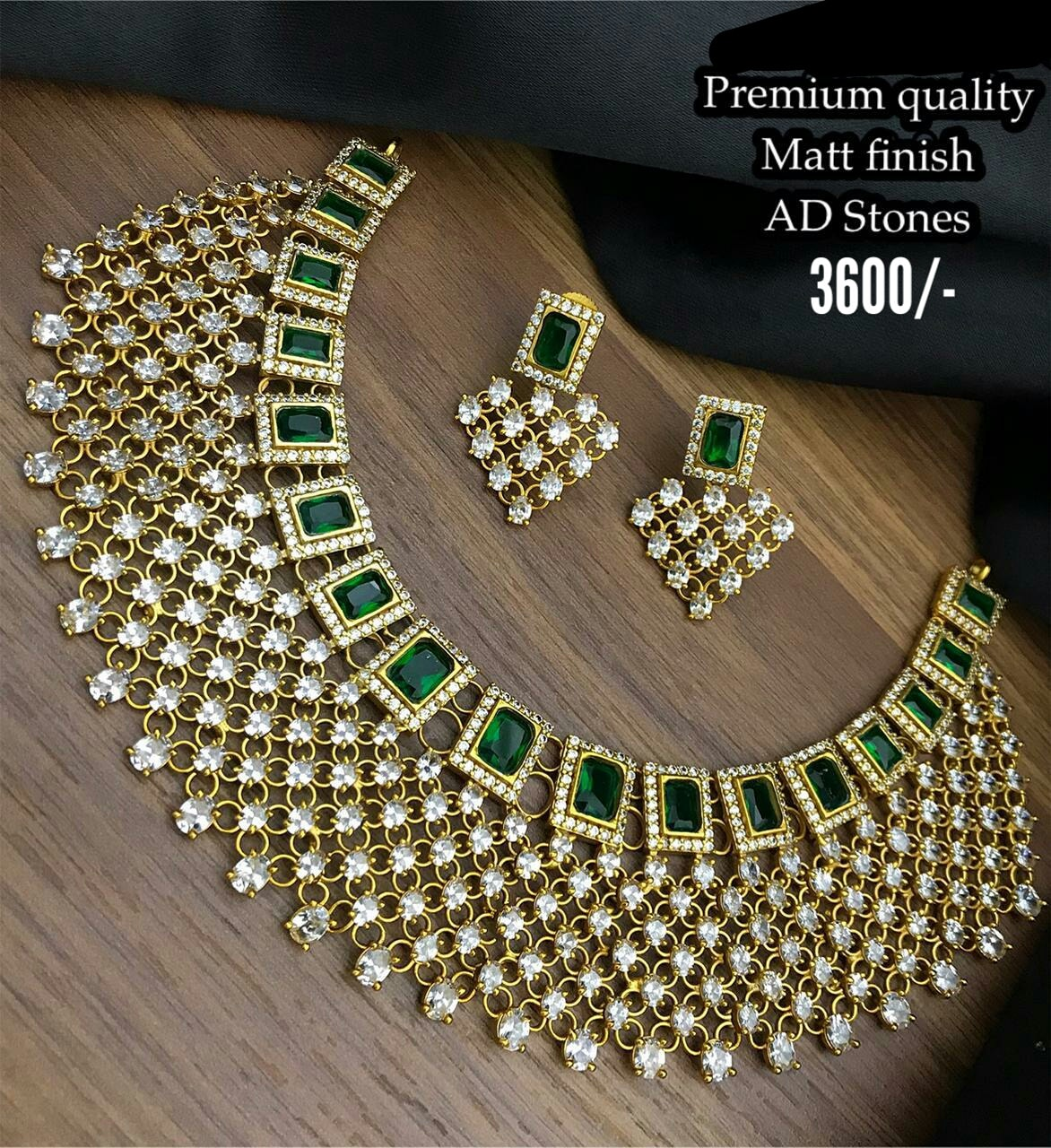 Stunning one gram gold necklace or choker studded with emerald and white color AD stones. Price : 3600/- one gram necklaces with price one gram gold jewellery parakkat 1 gram gold choker necklace sets with price