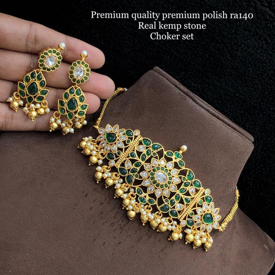 Gorgeous one gram gold choker set studded with kemp stones. Choker with guttapusalu hangings.