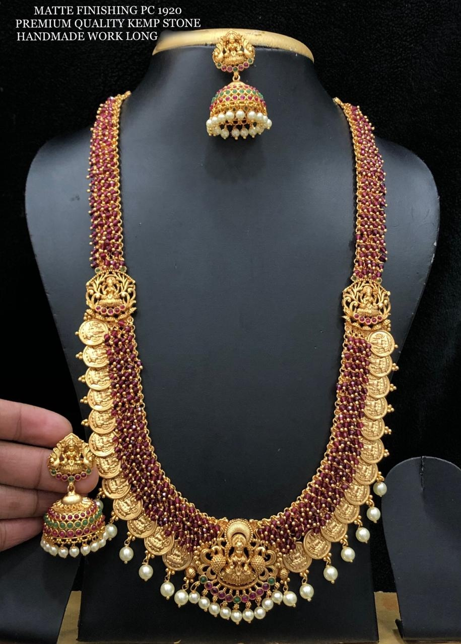 Gorgeous one gram gold or matte finish red guttapusalu long haaram with Lakshmi devi kasu hangings.  guttapusalu haram 1 gram gold online one gram gold imitation jewellery 1 gram gold jewellery designs collections with price