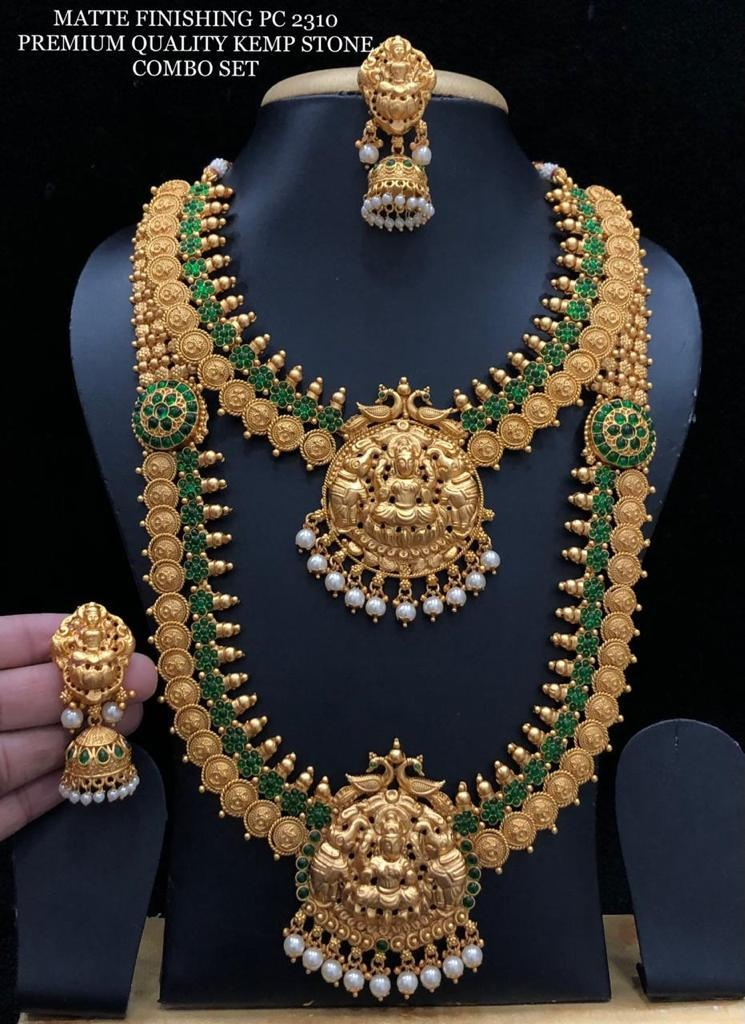 Gorgeous one gram gold or matte finish temple bridal set with Lakshmi devi kasu hangings. Bridal set studded with green stones.