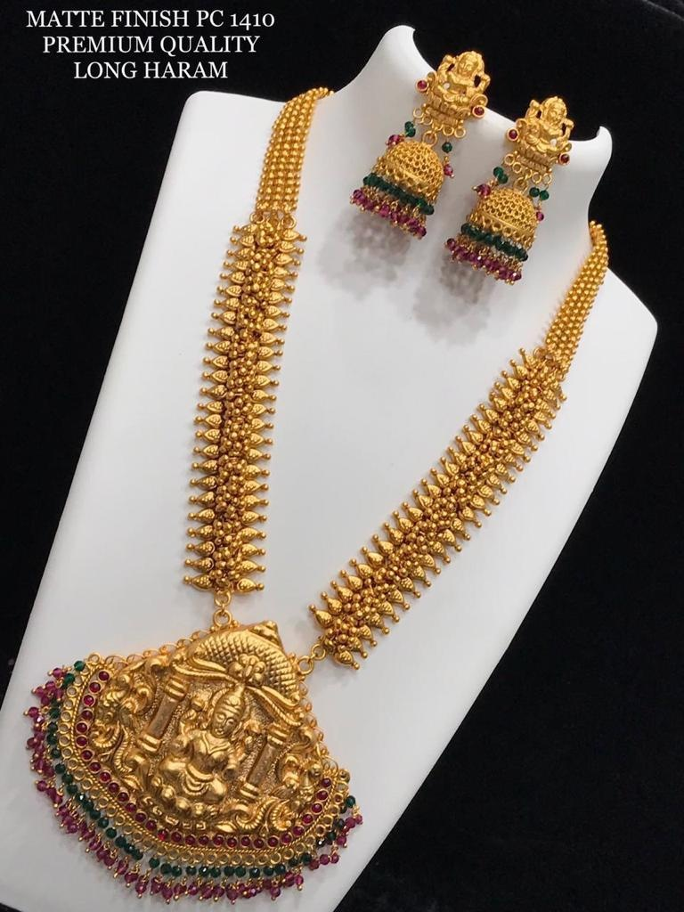 Gorgeous one gram gold or matte finish temple long haaram with matching lakshmi jumkhis. 60 grams gold haram models one gram gold jewellery designs with price one gram gold chains online shopping