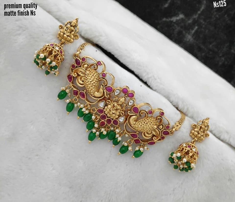 Stunning one gram gold peacock and Lakshmi devi choker with matching Lakshmi jumkhis.