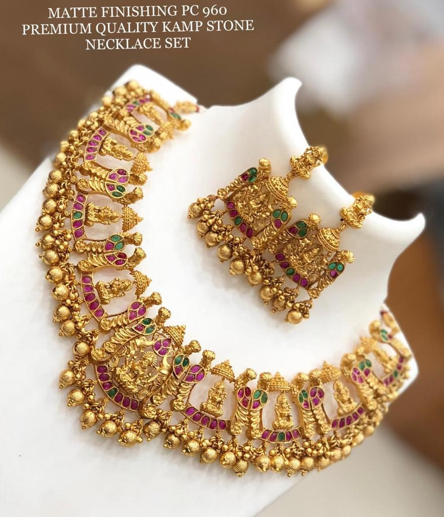 Stunning matte gold Lakshmi necklace set with matching earrings.  best 1 gram gold jewellery online one gram gold jewellery online shopping 1 gram jewellery set