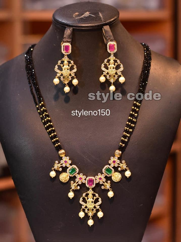 Beautiful matt finish black bead necklace with Laksmi pendant. 1 gm gold chain online best 1 gram gold jewellery online one gram gold long mangalsutra