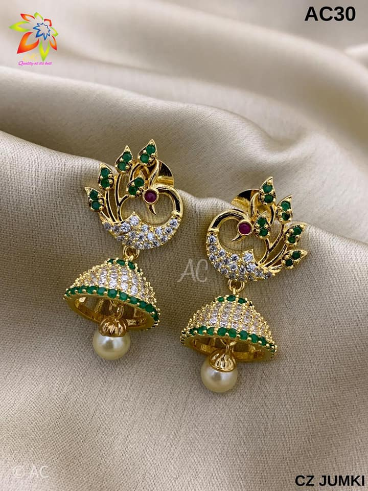 Beautiful one gram gold peacock jumkhis studded with white and green color czs.  one gram gold jewellery wholesale one gram gold jhumkas online 1 gram gold jhumkas buy online