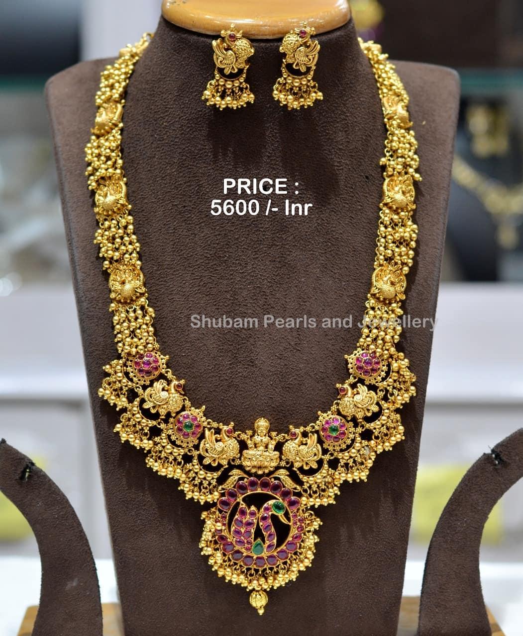 Beautiful one gram gold temple Laksjmi long haaram with muvvalu hangings.  Price : 5600/- one gram gold long chain designs 1 gram jewellery online one gram gold temple jewellery