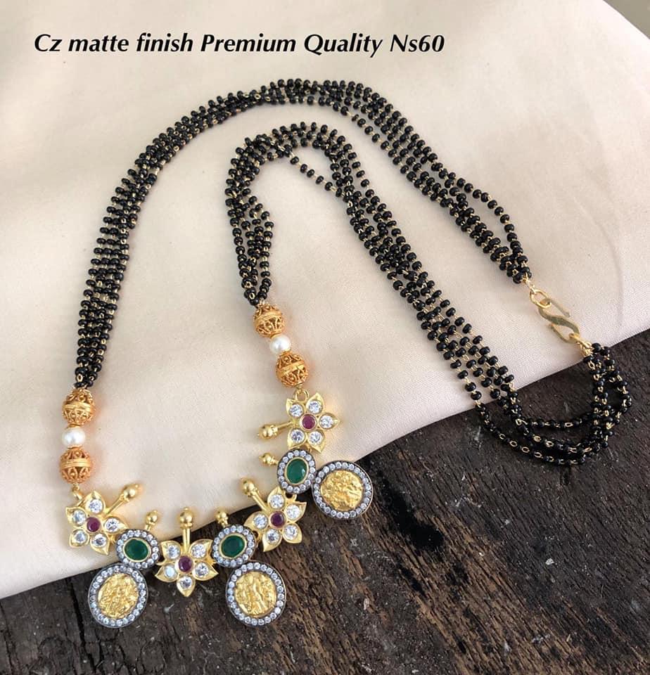Gorgeous one gram gold black bead set with Lakshmi devi kasu pendnat. 1 gm gold mangalsutra online one gram gold mangalsutra 1 gram gold black beads chains online