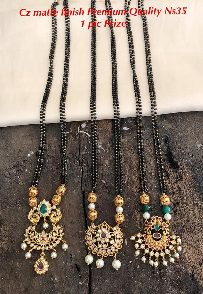 Gorgeous one gram gold black bead set with peacock  pendnat. 1 gm gold mangalsutra online one gram gold mangalsutra 1 gram gold black beads chains online