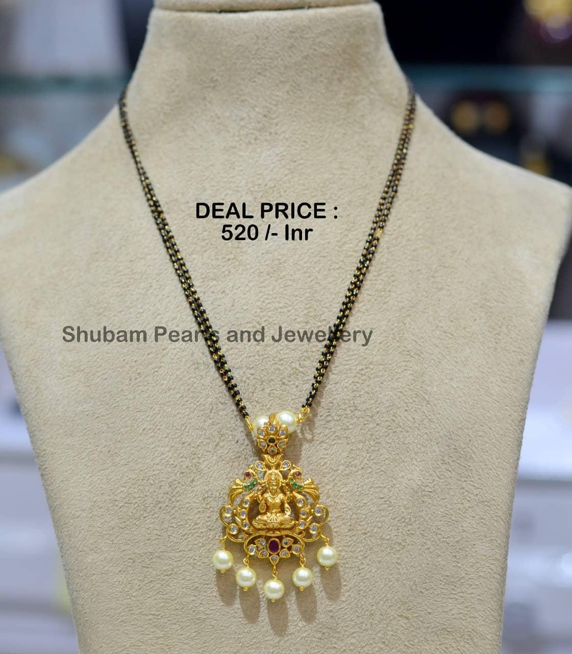 Beautiful one gram gold black bead chain with Lakshmi devi pendant.   one gram gold jewellery wholesale 1 gram gold nallapusalu 1 gram gold mangalsutra chain