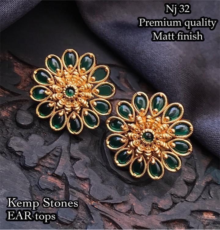Beautiful one gram gold ear studs studded with emerald kundans.  1 gram earrings one gram gold jewellery designs 1 gram gold jhumka earrings online